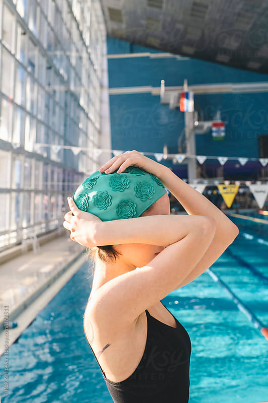 Side view of young woman in swimming cap by Danil Nevsky for Stocksy United