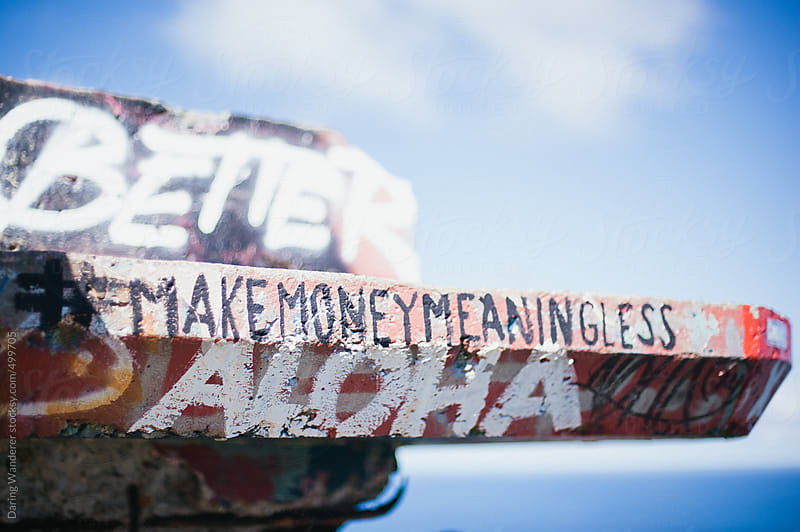 Make Money Meaningless graffiti hashtag quote on Pillbox in Oahu, Hawaii by Daring Wanderer for Stocksy United