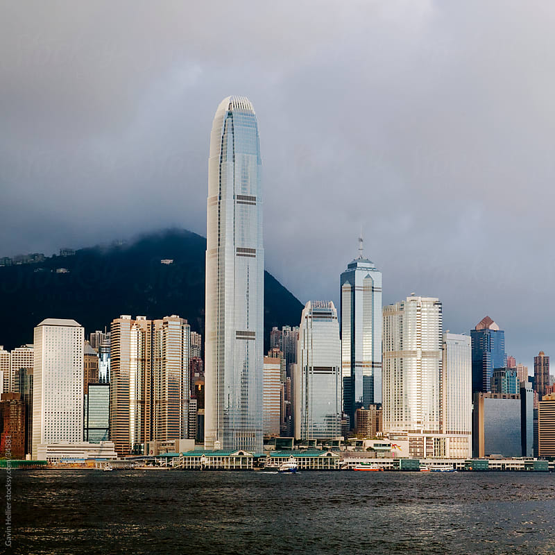 China, Hong Kong, Central District, skyscrapers in financial district, low angle view at night by Gavin Hellier for Stocksy United