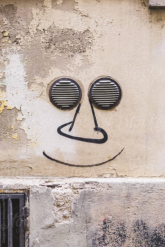 Funny Face Graffiti with Two Small Grates as Eyes by Giorgio Magini for Stocksy United