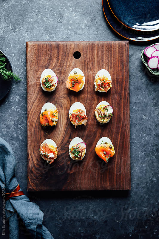 Deviled eggs three ways by Ellie Baygulov for Stocksy United