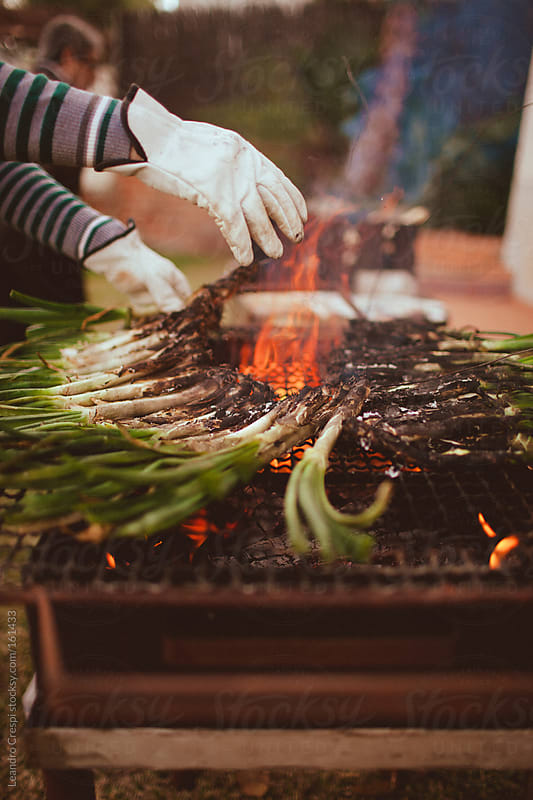 Typical catalonian calçots barbacue by Leandro Crespi for Stocksy United
