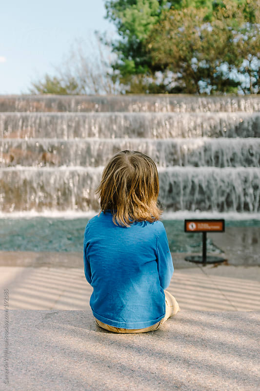 Young boy visiting the FDR memorial in Washington DC by Cameron Whitman for Stocksy United