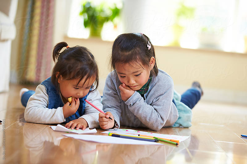 two little asian girls learning in home by Bo Bo for Stocksy United