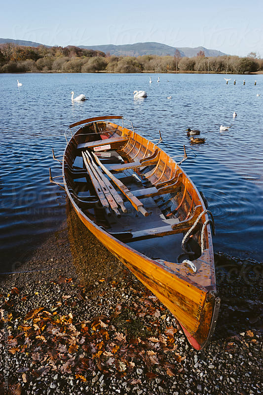 Rowing boat on the shore of Derwent Water.  by Liam Grant for Stocksy United