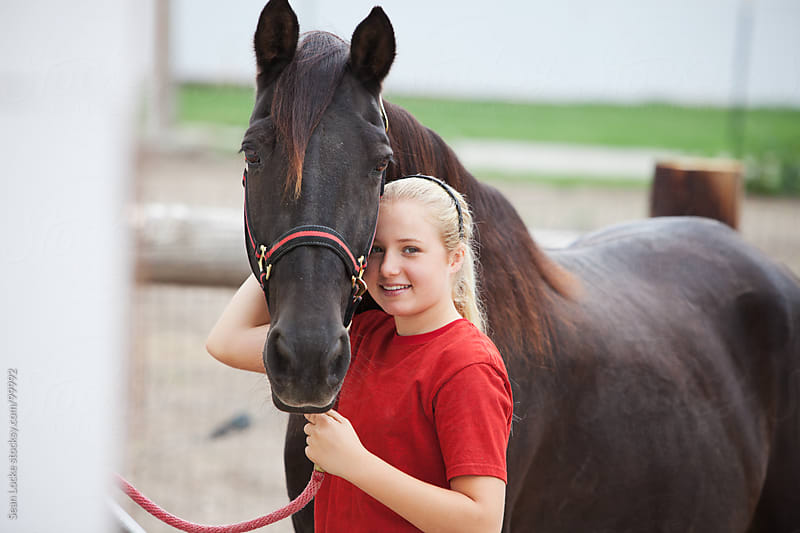 Equestrian: Young Woman and Her Horse by Sean Locke for Stocksy United