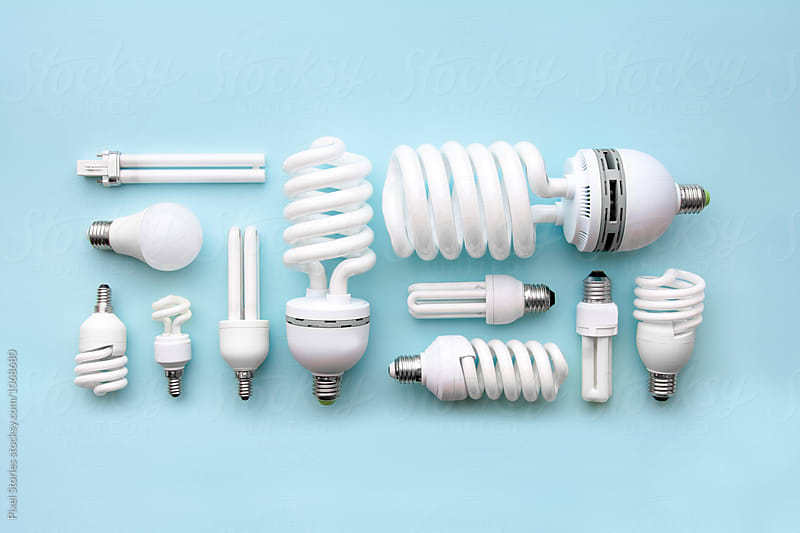 Energy-saving lightbulbs on blue background by Pixel Stories for Stocksy United