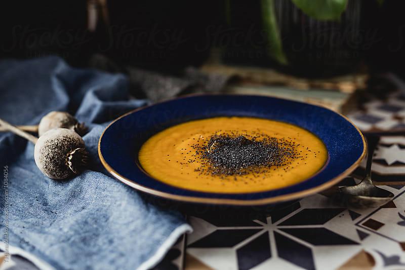Pumpkin soup with poppy seeds by Tatjana Ristanic for Stocksy United