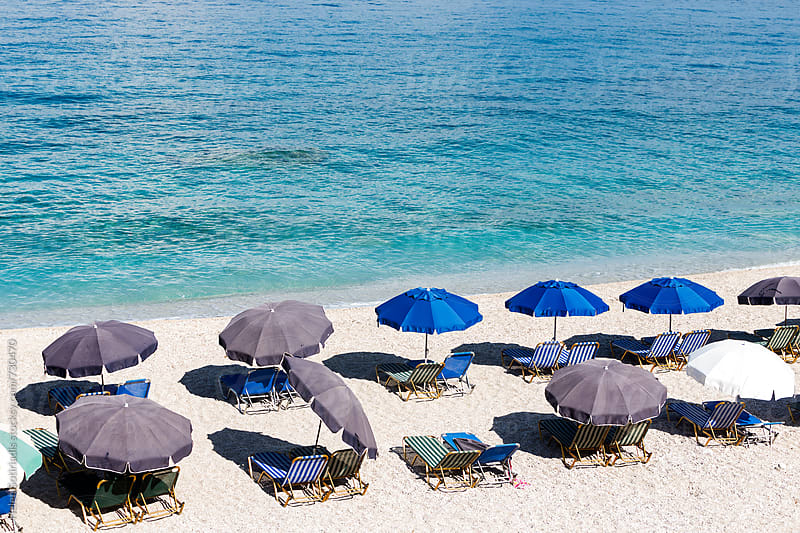 Umbrellas and Lounge Chairs on the Beach by Helen Sotiriadis for Stocksy United