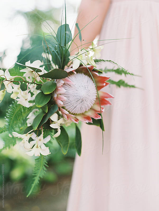 pink and white and green tropical floral bouquet for wedding by wendy laurel for Stocksy United