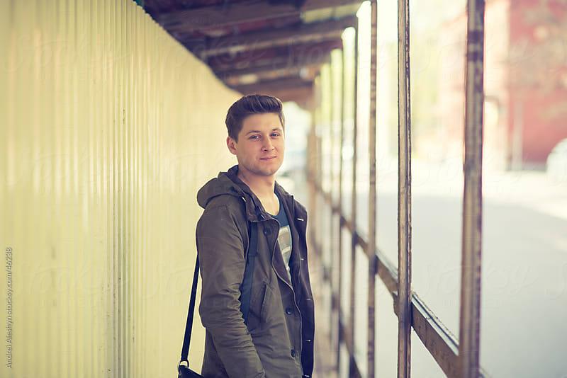 trendy guy posing in the street by Andrei Aleshyn for Stocksy United