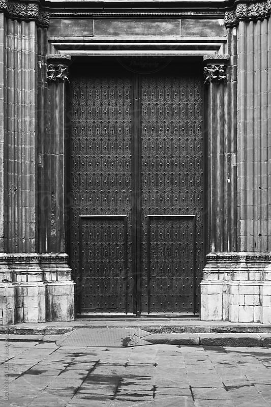 Door on el gothic streets, Barcelona. Black and white photo. by BONNINSTUDIO for Stocksy United
