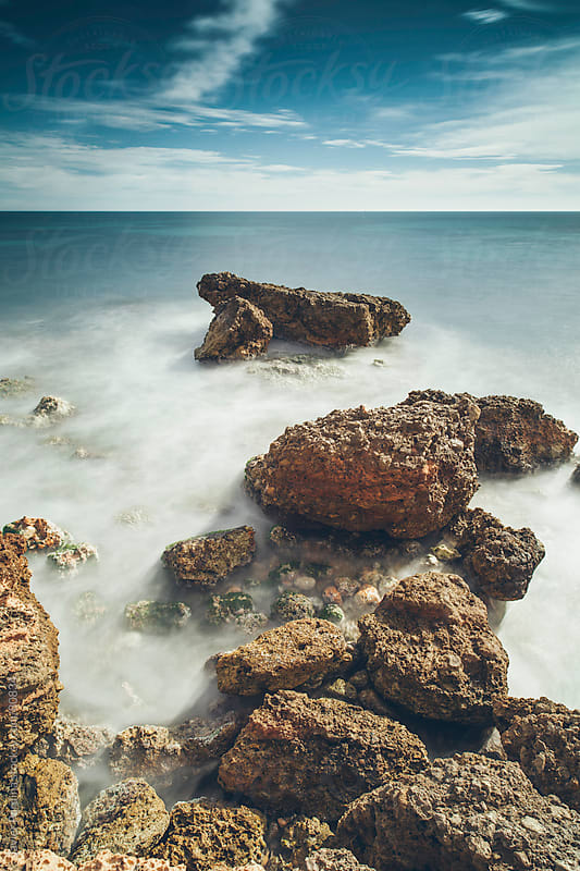 large stones on the mediterranean coast by Javier Pardina for Stocksy United