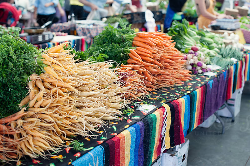 Carrots and Other Vegetables at A Farmer's Market by Leigh Love for Stocksy United