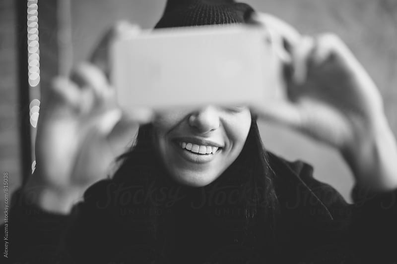 cool happy young woman  making selfie  by Vesna for Stocksy United