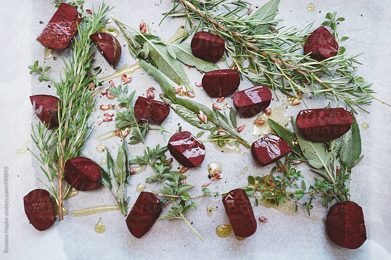 Fresh Herbs and Beetroot ready for roasting by Rowena Naylor for Stocksy United