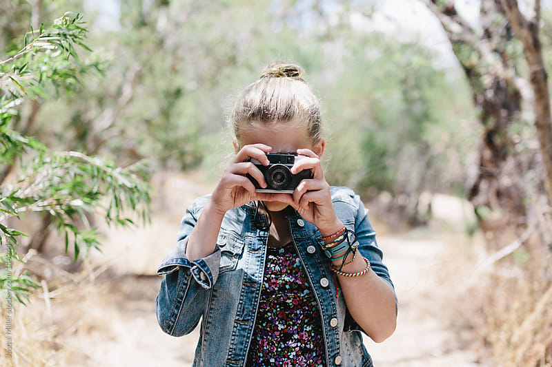 Teen girl taking a photo with a vintage film camera by Jacqui Miller for Stocksy United