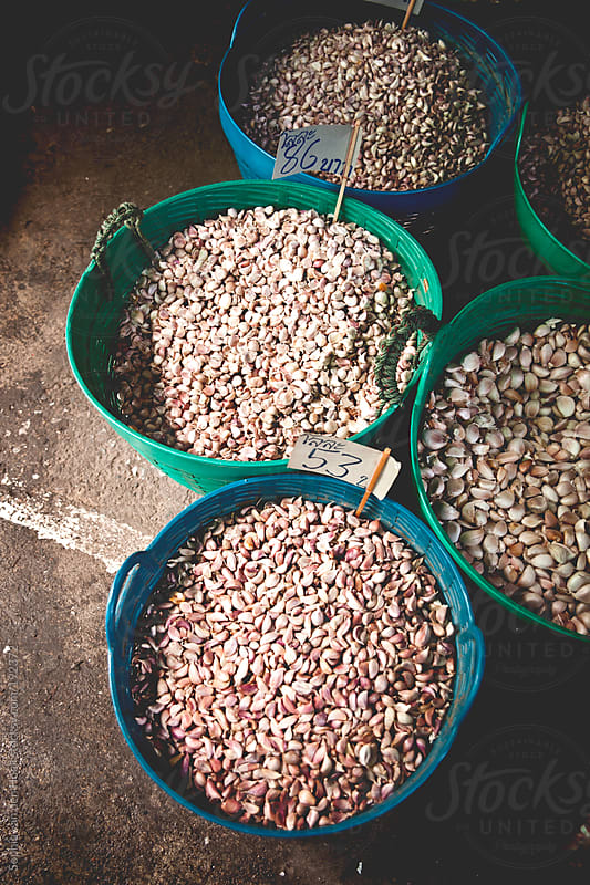 Garlic on Thai market by Sophia van den Hoek for Stocksy United