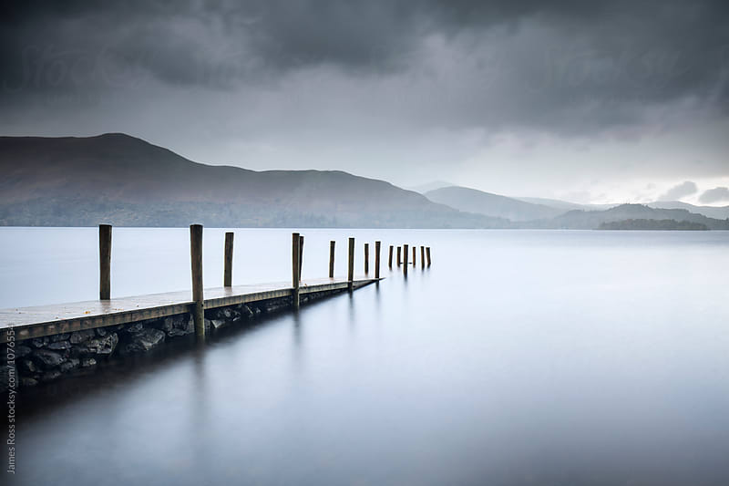 Jetty at dusk by James Ross for Stocksy United