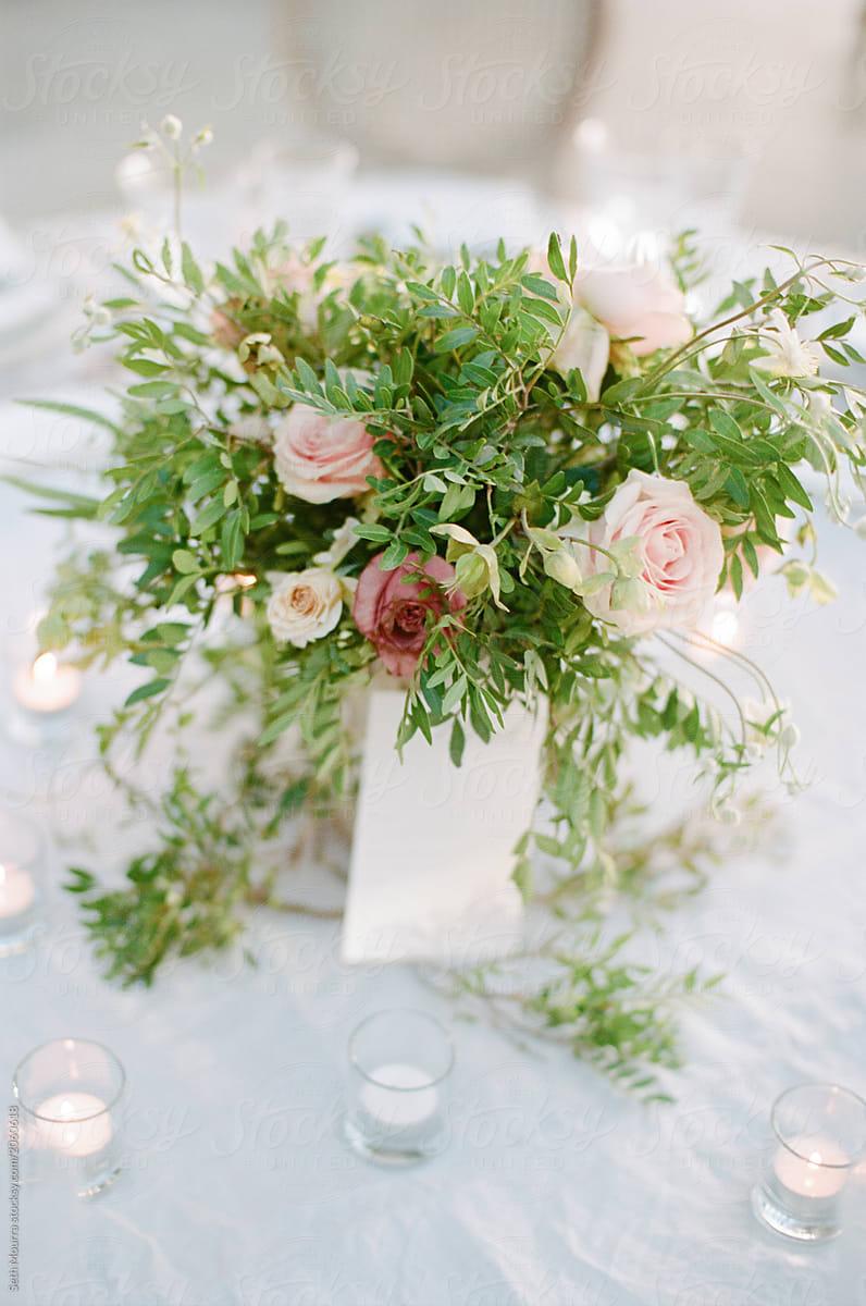 Elegant Overgrown Green Amp Soft Pink Flower Arrangement Stocksy