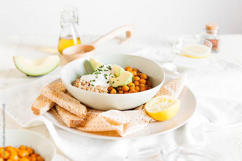 Spelt, chickpeas and avocado bowl with yogurt sauce by Nataša Mandić for Stocksy United