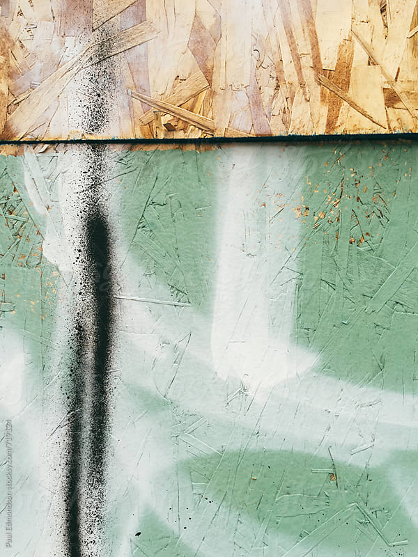 Graffiti and paint covering plywood wall, close up by Paul Edmondson for Stocksy United