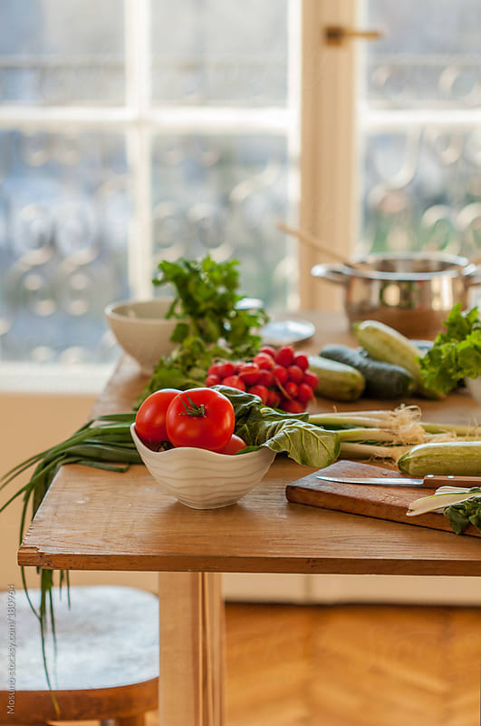 Close up of a Kitchen Table Full of Fresh Veggies by Mosuno for Stocksy United