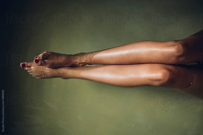 Woman's Legs in a Bathtub filled with Water. by Studio Firma for Stocksy United