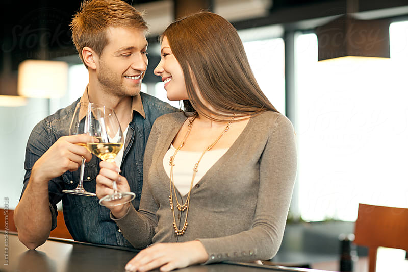 Couple in Love Drinking White Wine by Lumina for Stocksy United