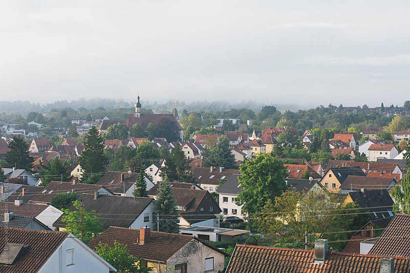 Overview of German village in the morning. by Ivo de Bruijn for Stocksy United