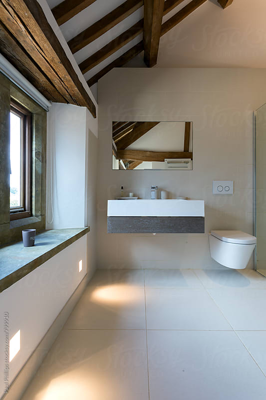 Entrance to a contemporary bathroom in a timber framed building by Paul Phillips for Stocksy United