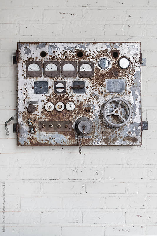 Old rusty regulator on a wall by Melanie Kintz for Stocksy United