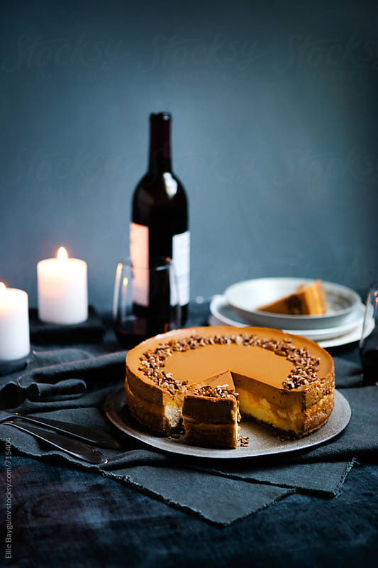 Dulce de leche cheesecake by Ellie Baygulov for Stocksy United