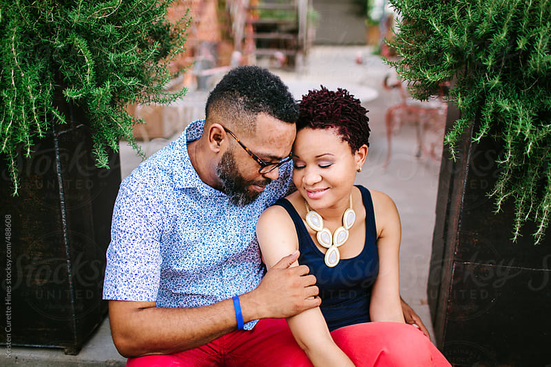 Portrait of a ethnic couple embracing each other by Kristen Curette Hines for Stocksy United