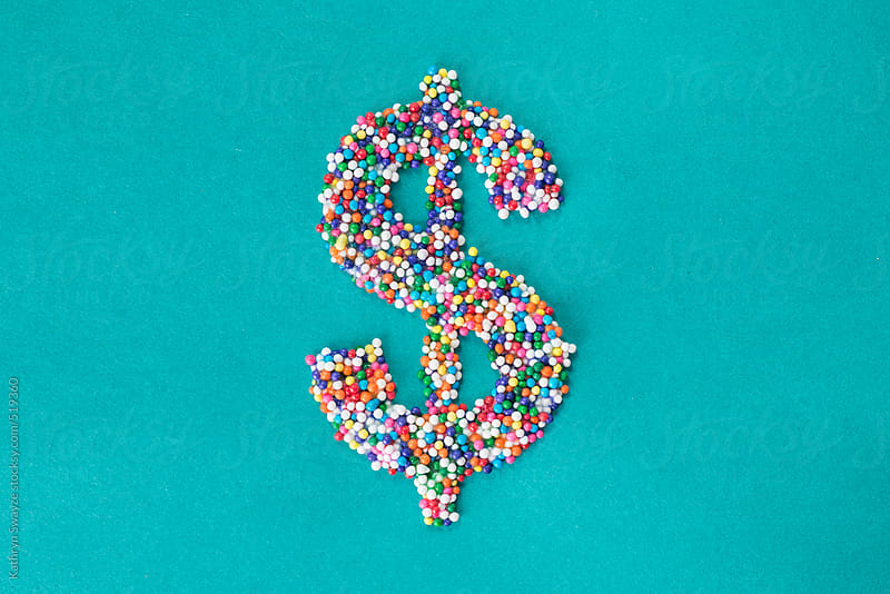 The dollar symbol built from nonpareils by Kathryn Swayze for Stocksy United