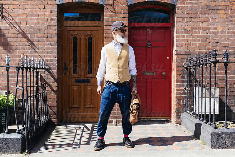 Eccentric Stylish Senior Man Portrait Out Of His House by HEX. for Stocksy United