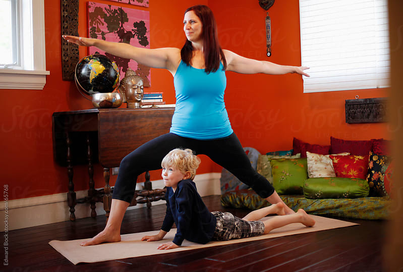 Mother and son practicing yoga at home by Edward Bock for Stocksy United