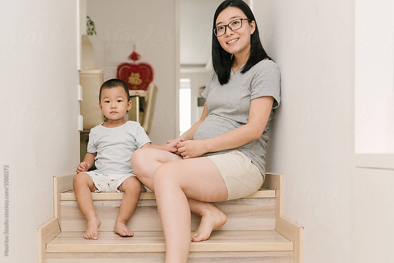 Portrait of young Chinese mother and her toddler son by Maa Hoo for Stocksy United
