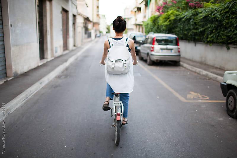 Girl on bike by Tommaso Tuzj for Stocksy United