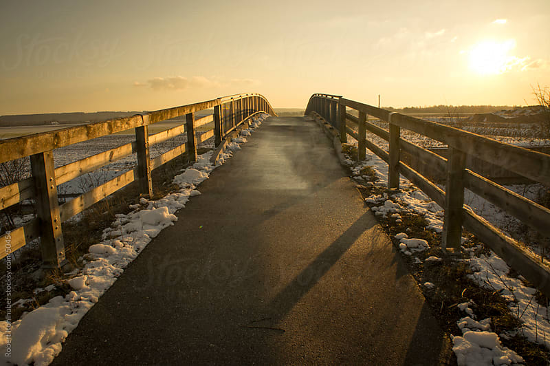 Bridge at dusk in winter landscape by Robert Kohlhuber for Stocksy United