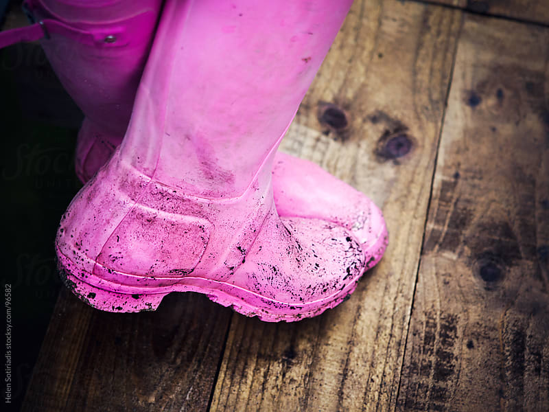 Pink galoshes by Helen Sotiriadis for Stocksy United