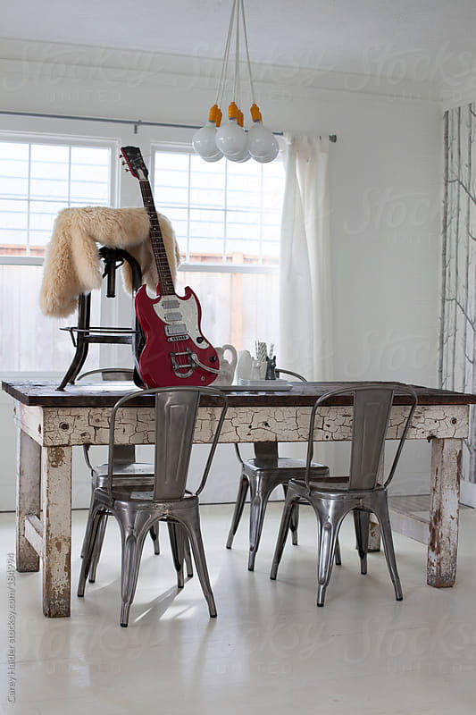 A Modern Dining Room Party With A Guitar by Carey Haider for Stocksy United