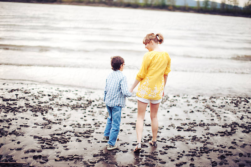 Small River Beach Family by Kevin Russ for Stocksy United