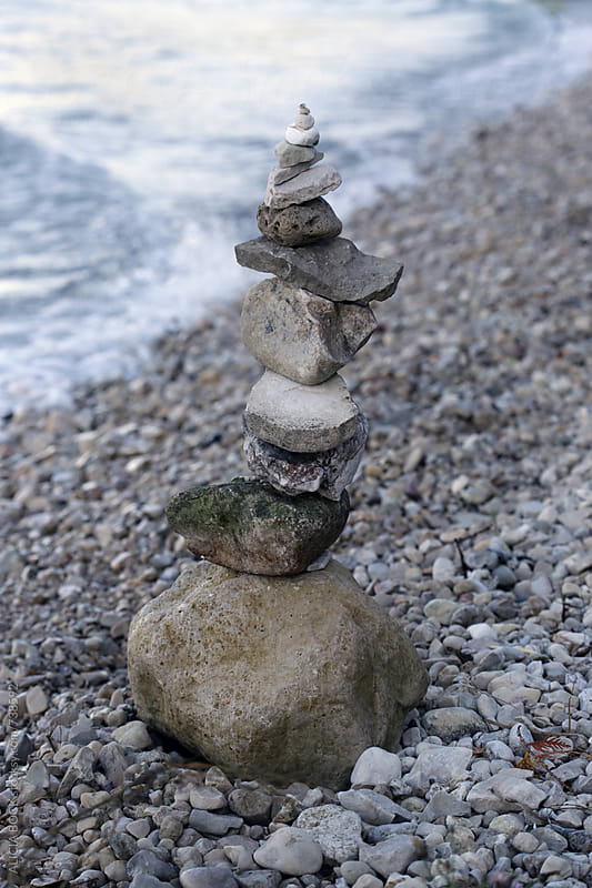 A Stack Of Balancing Stones On A Rocky Beach by ALICIA BOCK for Stocksy United