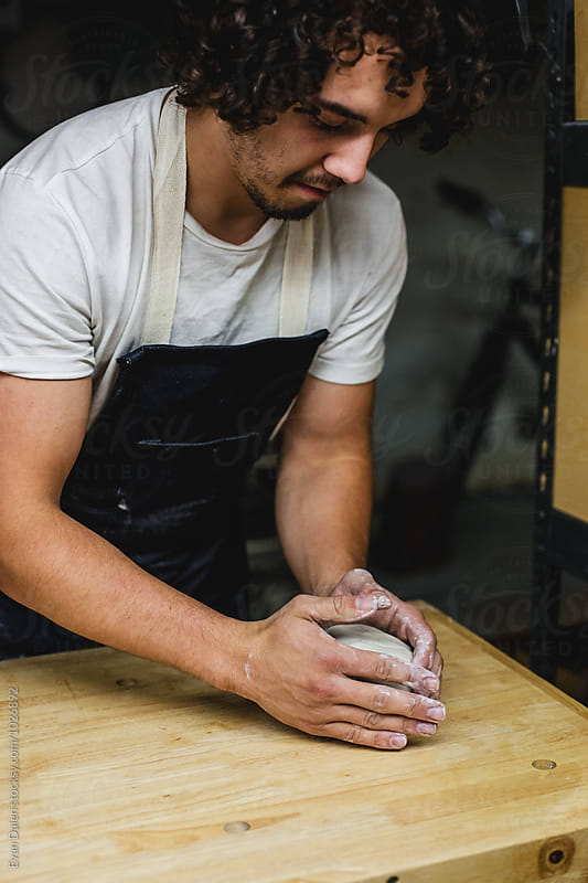 Potter Forming Clay by Evan Dalen for Stocksy United