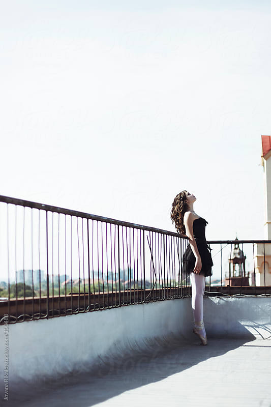 Ballet dancer on the top of the building  by Jovana Rikalo for Stocksy United