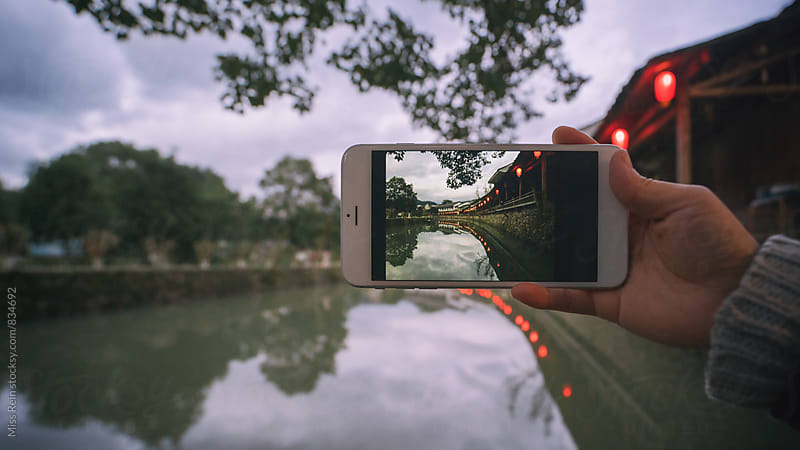 Take picture with a mobile smart phone,zhejiang,China by Miss Rein for Stocksy United