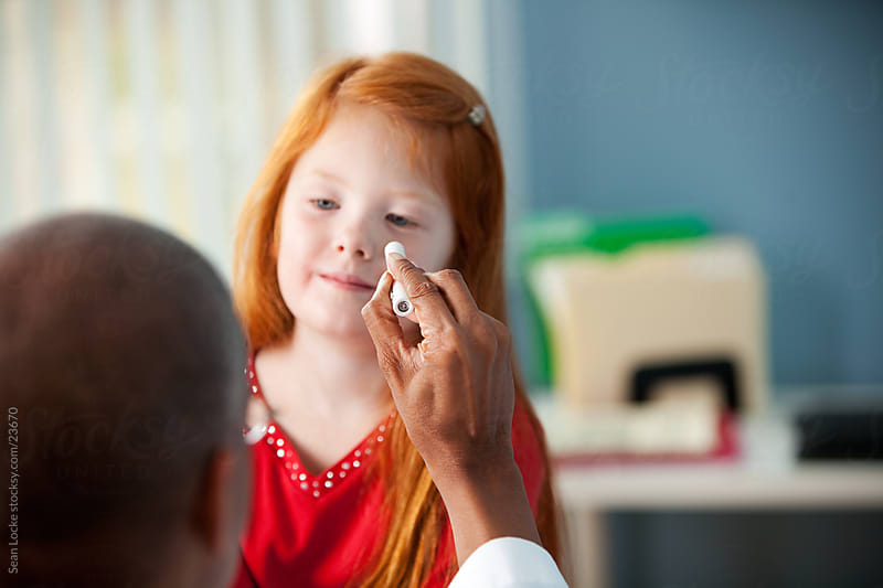 Exam Room: Doctor Checks Eyes of Patient by Sean Locke for Stocksy United