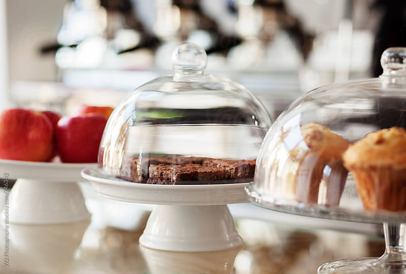 Baked goods on display at a cafe. by W2 Photography for Stocksy United