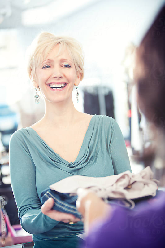 Boutique: Laughing Customer in Boutique by Sean Locke for Stocksy United